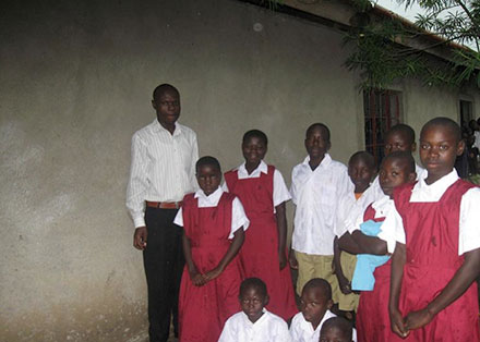 George Ongere and the humanist orphans in their new uniforms