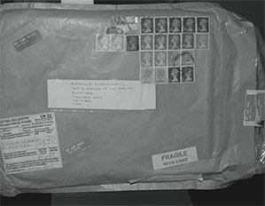 envelope with labels and many stamps