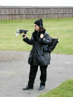 Figure 2. A ghost hunter uses a sensitive microphone, attempting to record ghostly sounds during an investigation in Ontario, Canada.