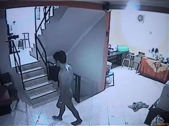 naked thief on security camera