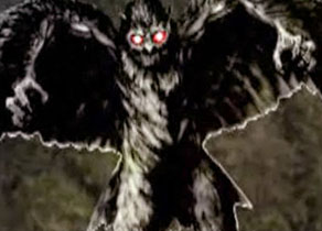 monster with arms, wings, and glowing eyes