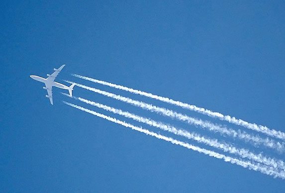 contrails of a four-engined jet