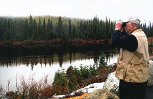 Joe Nickell looks through binoculars