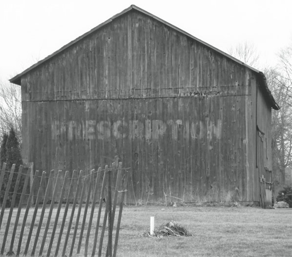 barn with the word PRESCRIPTION faintly visible