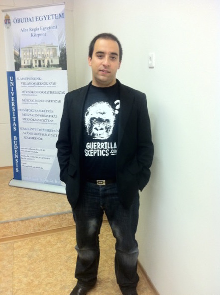 author wearing Guerrilla Skepticism on Wikipedia t-shirt