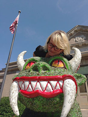 author with hodag statue