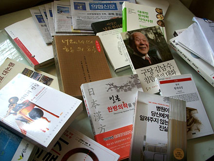 papers and books on a desk