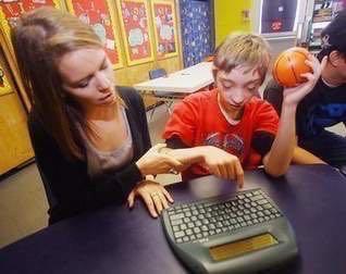 child works at keyboard